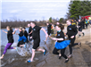 Members of the Newington Police Department entering the ice cold water