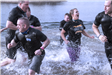 Members of the Newington Police Department in the water at polar plunge event