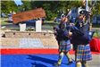 Bagpipers playing as they march by September 11, 2001 Memorial during dedication ceremony
