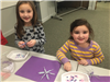 girls making pipe cleaner beaded snowflakes