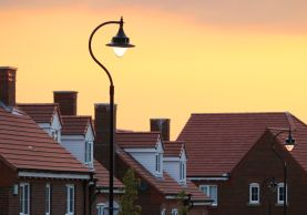Row of townhouses with street lamp at sundown