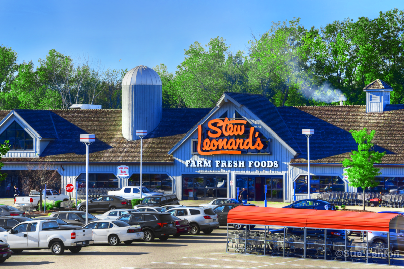 Parking lot view of Stew Leonard Supermarket front business entrance