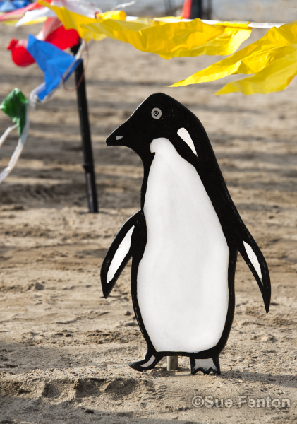 Decorative penguin sign used at polar plunge event
