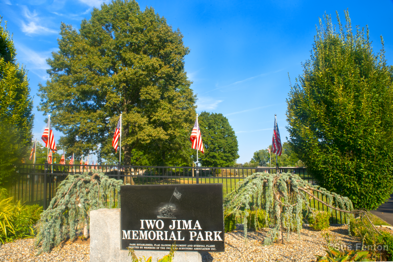 Iwo Jima Memorial Park sign and flags