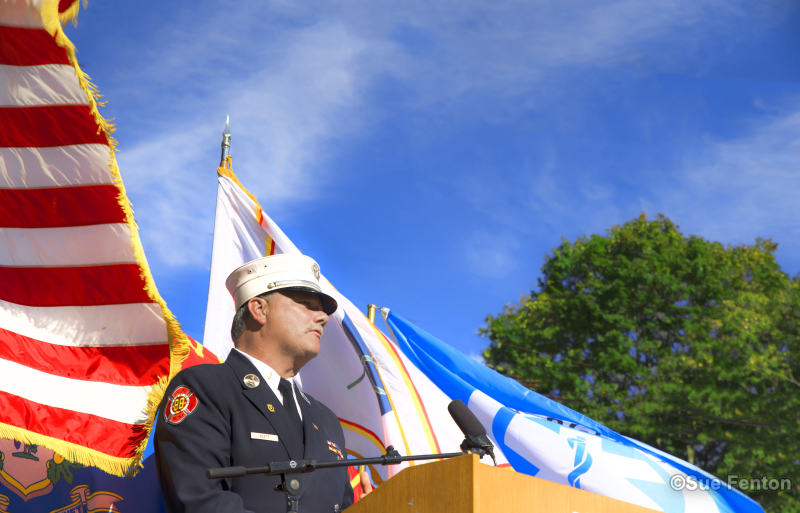 Firemen standing at lectern