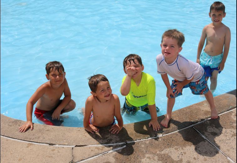 Five Boys at the Mill Pond Wading Pool posing for the camera
