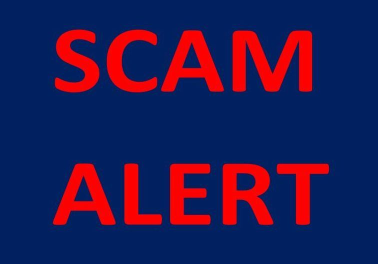 Scam Alert in red letters with a blue background.