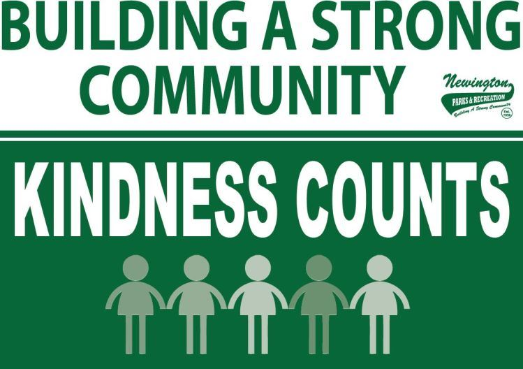 Green background with text reading &#34Kindness Counts&#34 and people below holding hands