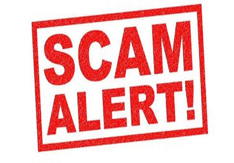 "Verbiage ""SCAM ALERT"" in bold red letters on a white background"