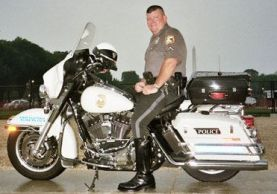 Officer Peter Lavery sitting on motorcycle