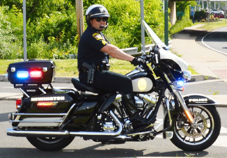 Uniformed Police Officer on Motorcycle
